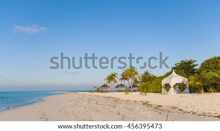 Tropical beach with Wedding Setup Tent - stock photo