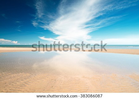 Tropical beach with white sand, fresh turquoise sea, deep blue sky and white clouds in Pranburi, Thailand. - stock photo