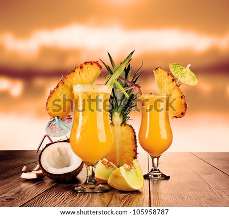 Tropical cocktails in evening sun - stock photo
