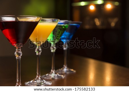 Tropical cocktails on counter - stock photo