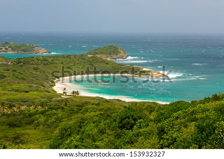 Tropical Deserted Beach in Half Moon Bay Antigua on Sunny Day - stock photo