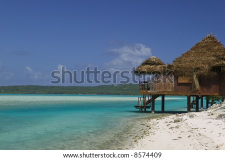 Tropical Dream Beach Paradise of the South Pacific with Over water Bungalows on a resort island - stock photo