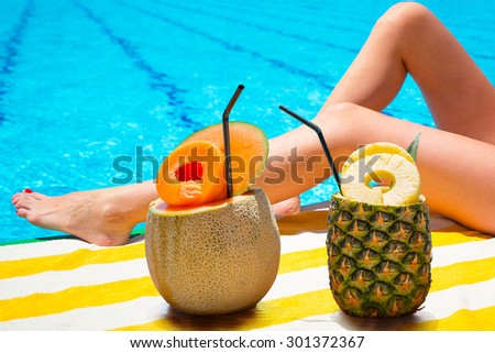 Tropical drinks at the swimming pool - stock photo