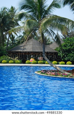 Tropical freshwater swimming beach - stock photo