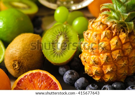 tropical fruit, pineapple, kiwi, lime, red, orange and blueberries. Flat Lay. Top view. - stock photo