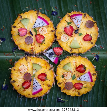 Tropical fruit pizza with pineapple, strawberry, kiwi,grapes, banana and dragon fruit - stock photo