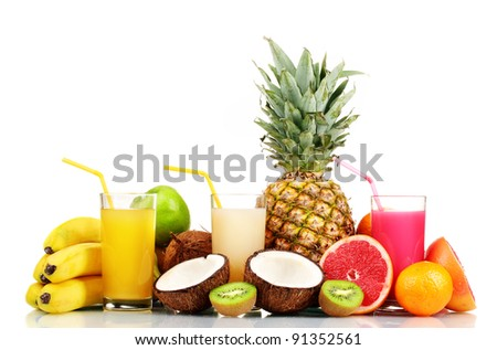 Tropical fruits and juice isolated on white - stock photo