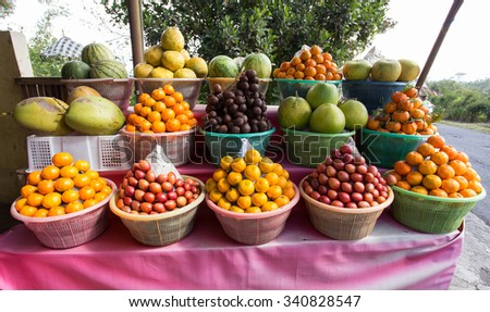 tropical fruits in baskets on fruit market, Kintamani, Bali Indonesia - stock photo