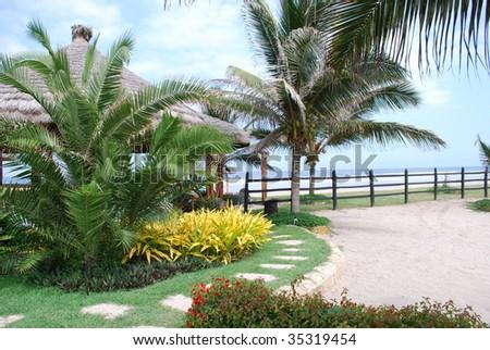 Tropical garden in the beach - stock photo