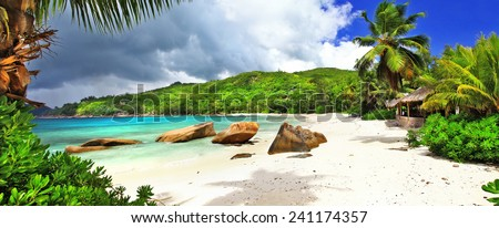tropical holidays in Seychelles , panoramic view of Takamaka bea - stock photo