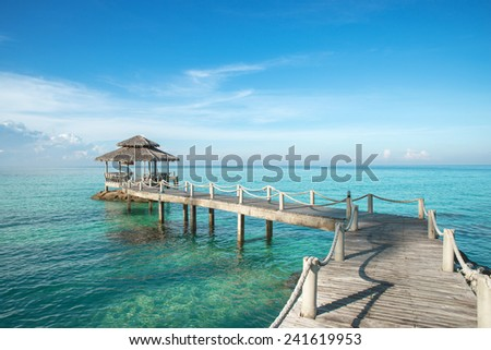 Tropical hut and wooden bridge at holiday resort.  Summer travel in Phuket ,Thailand. - stock photo