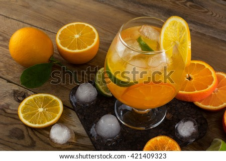 Tropical iced fruit cocktail on wooden table. Fruit cocktail.. Fruit lemonade. Fruit drink. Summer drink. Citrus lemonade - stock photo