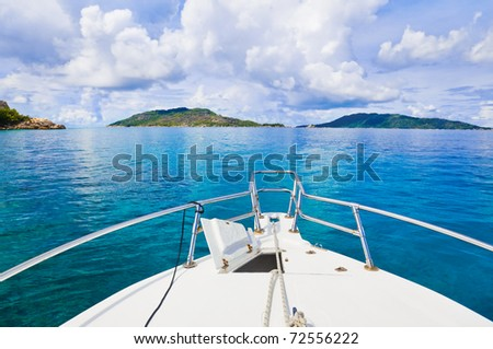 Tropical island and boat - nature background - stock photo