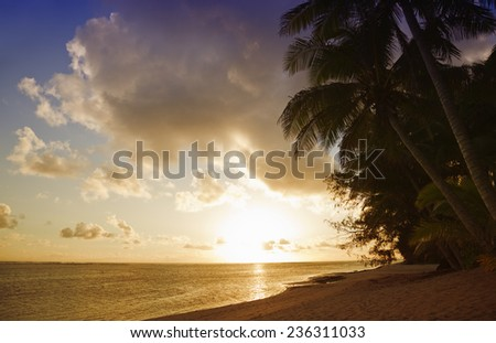 Tropical Island at Sunset - Rarotonga, Cook Islands, Polynesia - stock photo