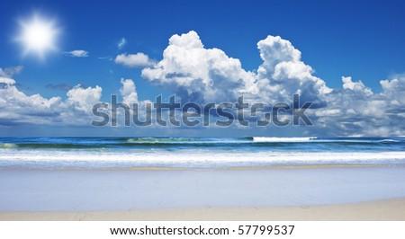Tropical island beach with sun and sky - stock photo