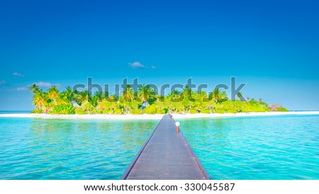 Tropical island in the ocean. - stock photo