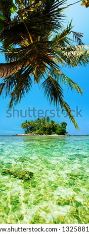 Tropical island. Panoramic vertical composition. - stock photo