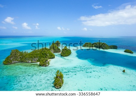 Tropical islands and clear blue water from above, Palau, Micronesia - stock photo