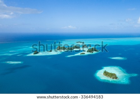Tropical islands, coral reefs and clear blue water from above by helicopter, Palau, Micronesia - stock photo
