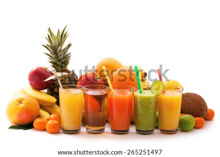 Tropical juices and fruit on white background. Assortment of exotic fruits - stock photo