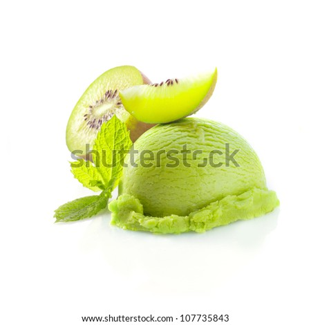 Tropical kiwi icecream dessert with delicious creamy green ice-cream served wioth fresh sliced kiwi fruit garnished with mint - stock photo