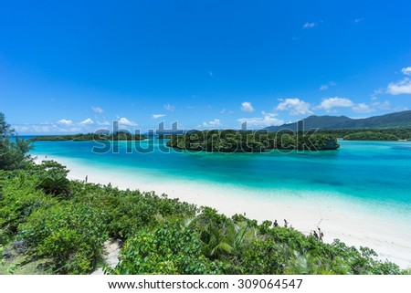 Tropical lagoon beach with clear turquoise water, white sand and blue sky, Kabira Bay, Ishigaki Island National Park of the Yaeyama Islands, Okinawa, Japan  - stock photo
