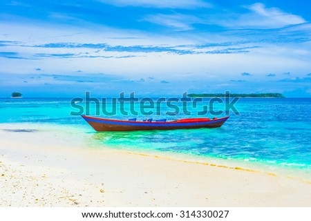 Tropical landscape with islands and lonely boat, Indonesia, Southeast Asia - stock photo