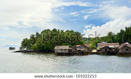 Tropical landscape with traditional Philippines fishermans  village. Shiargao island, Philippines - stock photo