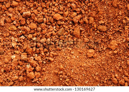 Tropical laterite soil or red earth background. - stock photo