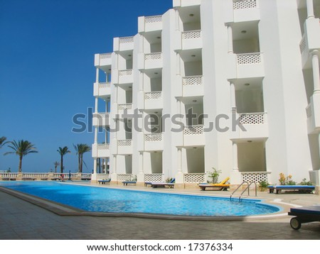 tropical luxury hotel resort building with swimming pool - stock photo