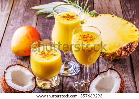 Tropical milkshake with ingredients, selective focus. - stock photo