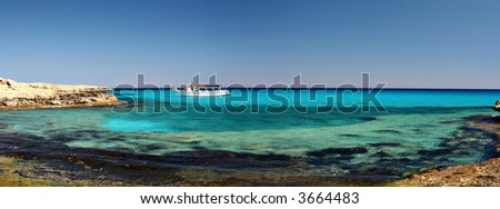 Tropical ocean and a boat - stock photo