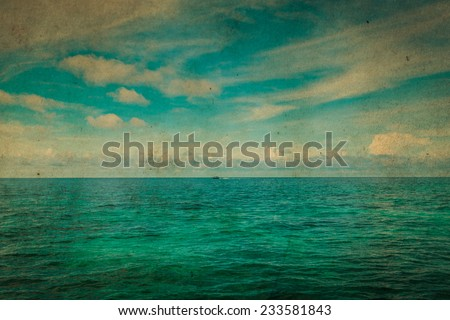 Tropical ocean and blue sky. Grunge paper filter. - stock photo