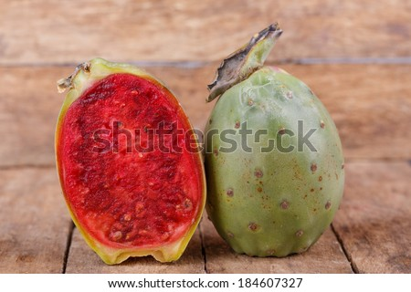 Tropical Opuntia Prickly Pear fruit on wooden background - stock photo