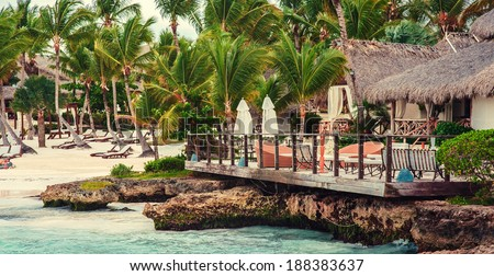 Tropical Paradise Beach. Dominican Republic, Seychelles, Caribbean, Mauritius, Philippines, Bahamas. Relaxing on remote Paradise beach. Vintage. - stock photo