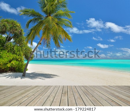 Tropical paradise beach with empty wooden pier  - stock photo