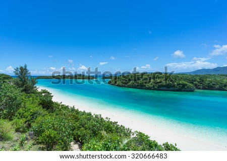 Tropical paradise lagoon, clear turquoise water and coral rock islands, Kabira Bay, Ishigaki Island National Park of the Yaeyama Islands, Okinawa, Japan - stock photo
