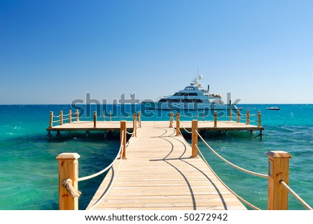 tropical pier - stock photo