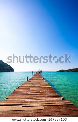 Tropical Resort. boardwalk on beach - stock photo