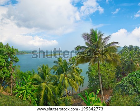 Tropical river and island in the middle of its. Terekhol River, North Goa, India - stock photo