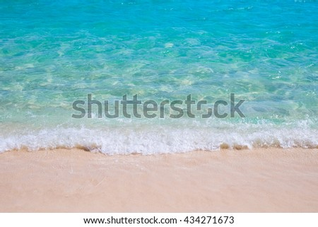Tropical sand beach and blue sea wave - stock photo