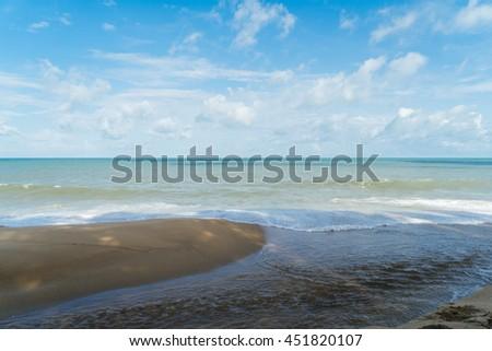 Tropical sand beach in Indian sea, Phuket, Tailand. Nobody at beautiful beach. Sea waves, white sand, paradise beach. Island beach with blue water. Sea foam on beach. Paradise beach.  - stock photo