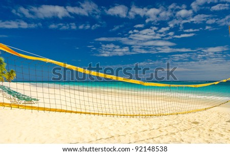 Tropical sand beach with volleyball net. - stock photo