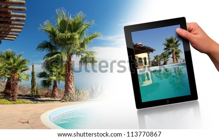 Tropical Scene with swimming pool and tablet pc - stock photo