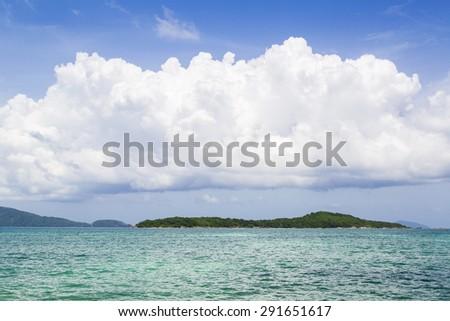 Tropical sea and island in summer - stock photo
