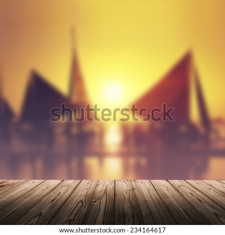 Tropical sea background with wooden table and sunset over the sea. Boracay, Philippines. - stock photo