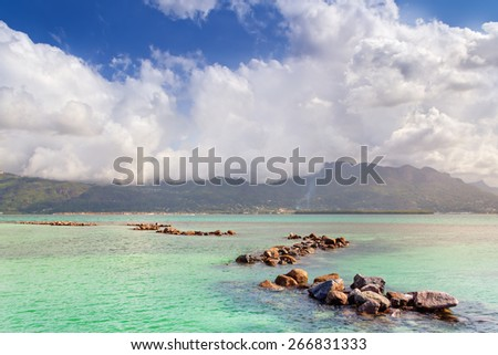 Tropical Seascape with stones on foreground  - stock photo