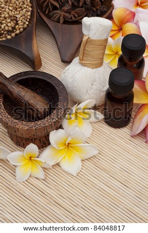 tropical spa therapy with colorful flowers - stock photo