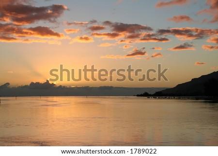 Tropical sunrise on the lagoon - stock photo