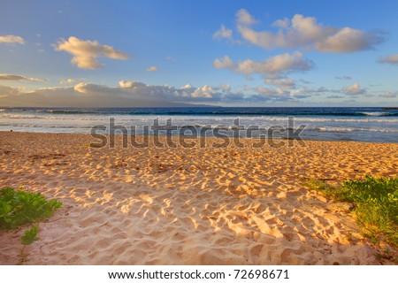 Tropical sunset on large empty golden sand beach. Maui Hawaii - stock photo
